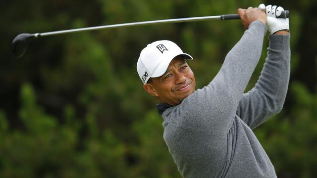 Golf - Woods cannot wait for Abu Dhabi