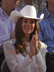 FILE - In this July 8, 2011 file photo, Kate, the Duchess of Cambridge, watches the Calgary Stampede parade in Calgary, Canada as the Royal couple continue their Royal Tour of Canada. The Duchess of Cambridge is turning 30 on Monday, Jan. 9, 2011 - but royal fans expecting a lavish birthday bash to mark the milestone will be disappointed. (AP Photo/Charlie Riedel, File)