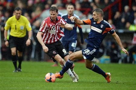 Sheffield United's Porter challenges Fulham's Hughes during their FA Cup soccer match at Bramhall Lane in Sheffield