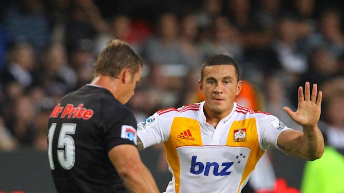 New Zealand Waikato Chiefs' Sonny Bill Williams (R) charges Sharks of Durban's Louis Ludik during the Super 15 rugby union match Sharks of Durban vs Waikato Chiefs of New Zealand at the Mr Price Kings Park Rugby Stadium on April 21, 2012.   AFP PHOTO/ STR (Photo credit should read -/AFP/Getty Images)