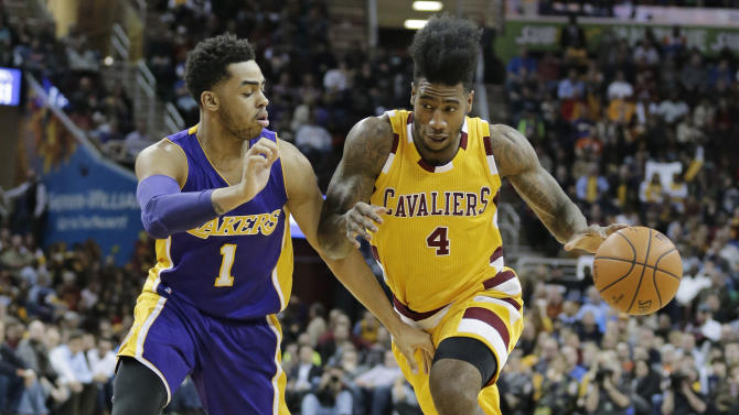 Cleveland Cavaliers' Iman Shumpert (4) drives past Los Angeles Lakers' D'Angelo Russell (1) in the second half of an NBA basketball game Wednesday, Feb. 10, 2016, in Cleveland. The Cavaliers won 120-111. (AP Photo/Tony Dejak)