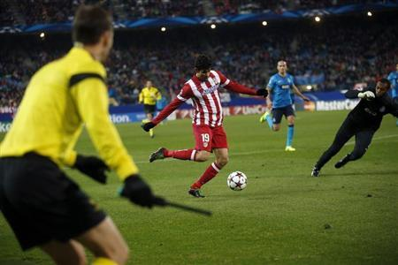 Atletico Madrid's Diego Costa shoots to score during their Champions League soccer match against Porto at Vicente Calderon stadium in Madrid