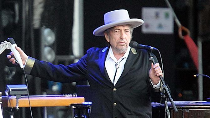 "FILE - This July 22, 2012 file photo shows U.S. singer-songwriter Bob Dylan performing on at ""Les Vieilles Charrues"" Festival in Carhaix, western France.   It's a crowded tour market and everyone is competing for your entertainment dollar. Dylan put together the Americanarama Festival of Music with My Morning Jacket and Wilco. (AP Photo/David Vincent, file)"