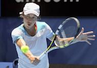 Francesca Schiavone of Italy hits a return against Tatjana Malek of Germany during their women's singles match at the Hopman Cup in Perth on January 2, 2013. Former French Open champion Schiavone showed her fighting qualities as Italy beat Germany 2-1