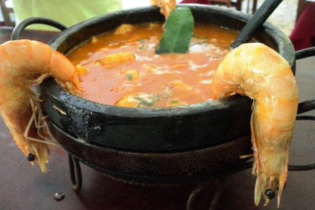 This Brazilian fish stew with fried shrimps is one of the country's most famous dishes. It's easy to make, has great texture, and is full of flavor. The shrimp is fried in palm oil with spices and coc