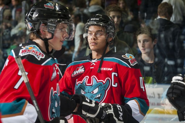 KELOWNA, CANADA - NOVEMBER 7: Madison Bowey #4 of Kelowna Rockets congratulates teammates on the win against the Spokane Chiefs as they exit the ice for the dressing room on November 7, 2014 at Prospera Place in Kelowna, British Columbia, Canada.  (Photo by Marissa Baecker/Getty Images)
