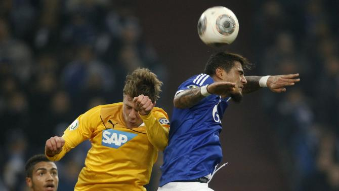 Schalke 04's Kevin-Prince Boateng and Hoffenehim's Sven Schipplock (C) head a ball during their third round German soccer cup (DFB-Pokal) match in Gelsenkirchen