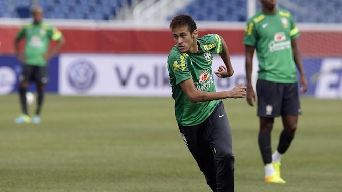 Neymar, a forward on Brazil's national soccer team, dribbles a ball during practice in Foxborough, Mass., Monday, Sept. 9, 2013. Portugal will play team Brazil in a friendly match Tuesday in Foxborough