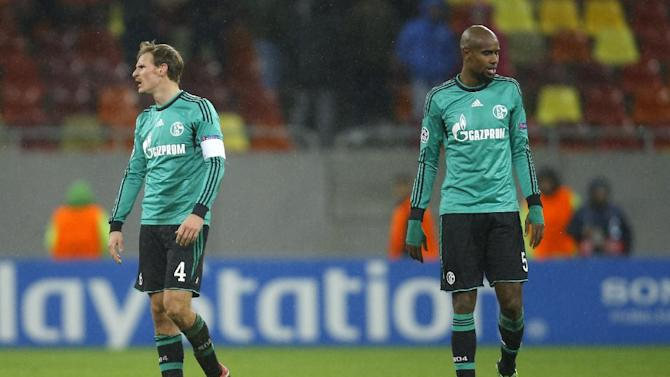 Schalke's Benedikt Hoewedes, left, and Felipe Santana, right, walk at the end of a Champions League Group E soccer match against Steaua Bucharest, at the National Arena in Bucharest, Romania, Tuesday, Nov. 26, 2013