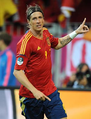 Fernando Torres bagged a brace as Spain eased to victory