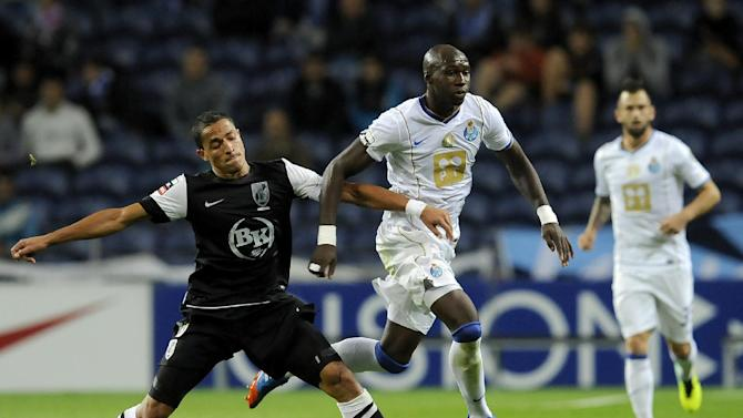 FC Porto's Eliaquim Mangala, from France, drives the ball past Vitoria Guimaraes' Leonel Olimpio, center, from Brazil, with Steven Defour from Belgium at right, in a Portuguese League soccer match at the Dragao Stadium in Porto, Portugal, Friday, Sept. 27, 2013. Porto won 1-0