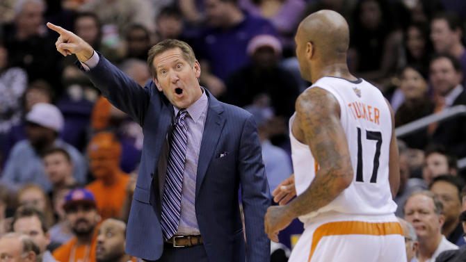 Phoenix Suns head coach Jeff Hornacek, left, yells to his team as P.J. Tucker runs upcourt against the Memphis Grizzlies  during the first half of an NBA basketball game on Thursday, Jan. 2, 2014, in Phoenix
