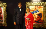 "In this Monday, Nov. 12, 2012 photo, Bollywood megastar Amitabh Bachchan and his wife Jaya Bachchan pose for photographs during the premiere of the film ""Jab Tak Hai Jaan"" or ""As long as I Am Alive"" in Mumbai, India. Bollywood stars turned out in strength at the premiere of the movie for a final homage to movie mogul Yash Chopra, who died last month days after finishing the film. Chopra was known as the ""King of Romance"" for creating classic love stories that were immensely popular. (AP Photo/Rafiq Maqbool)"