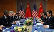 "The US delegation (left) holds talks with thier Chinese counterparts in Seoul. China has expressed ""serious concern"" to its ally North Korea about a planned rocket launch, a US official said after talks between President Barack Obama and President Hu Jintao"