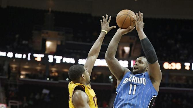 Orlando Magic's Glen Davis, right, shoots over Cleveland Cavaliers' Tristan Thompson, from Canada, during the fourth quarter of an NBA basketball game Thursday, Jan. 2, 2014, in Cleveland. The Cavaliers won 87-81
