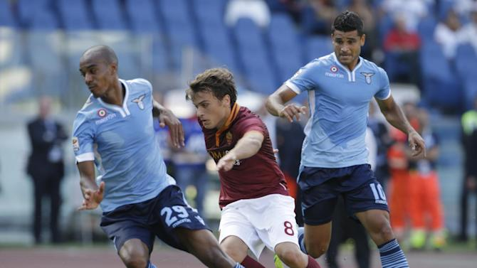 AS Roma forward Adem Ljajic of Serbia, center, dribbles past Lazio defender Abdoulay Konko of France, left, and Lazio midfielder Ederson of Brazil during a Serie A soccer match at Rome's Olympic stadium, Sunday, Sept. 22, 2013