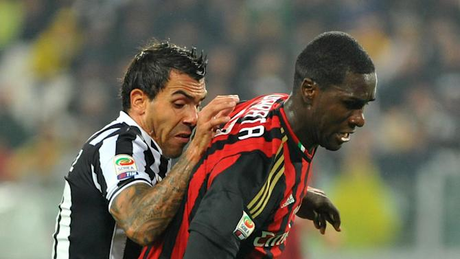 Juventus forward Carlos Tevez, of Argentina, left, fights for the ball with AC Milan defender Cristian Zapata, of Colombia, during a Serie A soccer match between Juventus and AC Milan at the Juventus stadium, in Turin, Italy, Sunday, Oct. 6, 2013