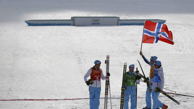 Norway's team celebrates after the flower ceremony for the Nordic Combined team Gundersen event of the Sochi 2014 Winter Olympic Games