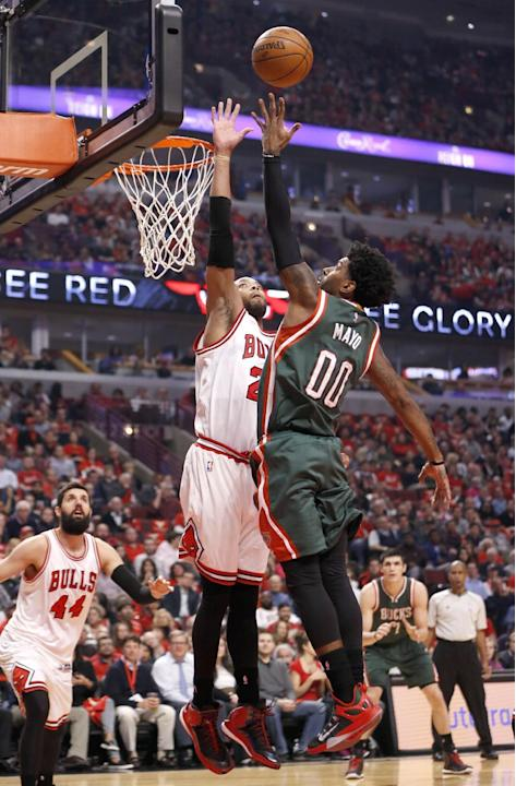 Milwaukee Bucks guard O.J. Mayo (00) shoots over Chicago Bulls forward Taj Gibson during the first half in Game 5 of the NBA basketball playoffs Monday, April 27, 2015, in Chicago. (AP Photo/Charles R