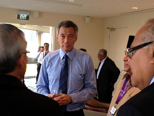 Prime Minister Lee Hsien Loong speaks with leaders and invited guests at the International Conference on Terrorism Rehabilitation and Community Resilience on Tuesday, 26 March 2013. (Yahoo! photo)