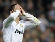 Real Madrid's Cristiano Ronaldo reacts after missing his penalty during the penalty shoot out at the Champions League second leg semi-final against Bayern Munich at the Santiago Bernabeu stadium on Wednesday. The Spanish capital is in shock after Real Madrid were knocked out of the Champions League when they lost a penalty shootout