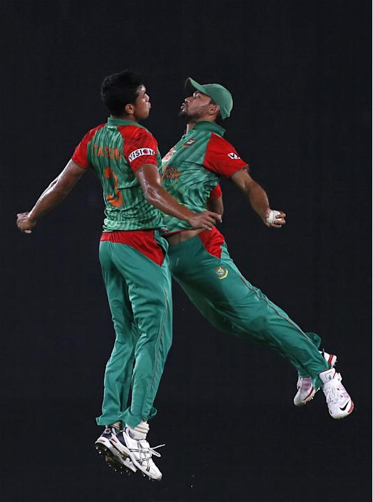 In this April 24, 2015 file photo, Bangladesh's Taskin Ahmed, left, and captain Mashrafe Mortaza celebrate the dismissal of Pakistan's Ahmed Shehzad during their Twenty20 cricket match in Dhaka, Bangl