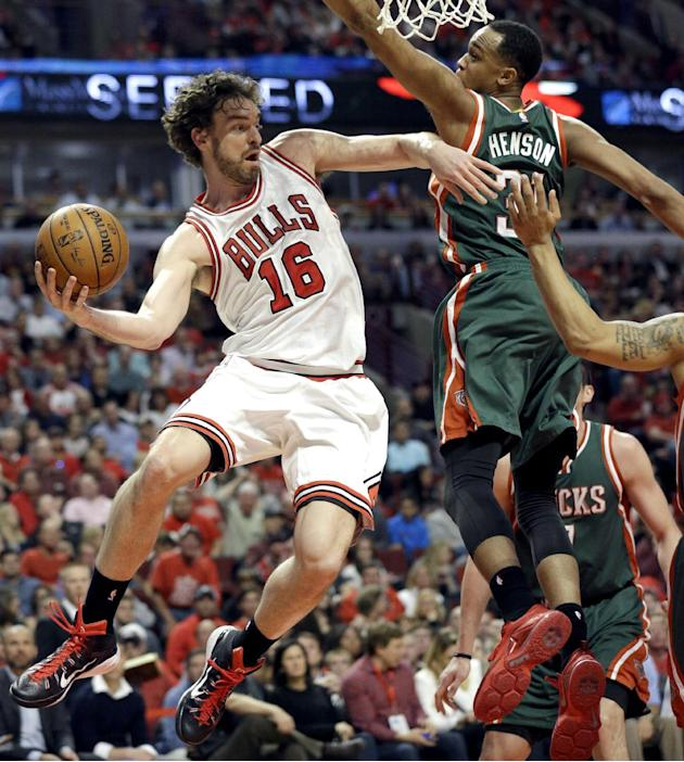 Chicago Bulls forward Pau Gasol, left, looks to a pass against the Milwaukee Bucks during the second half in Game 1 of the NBA basketball playoffs Saturday, April 18, 2015, in Chicago. (AP Photo/Nam Y