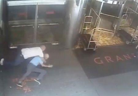 Ex-tennis star James Blake is shown tackled by a NYPD officer James Frascatore in front of the Grand Hyatt hotel in New York