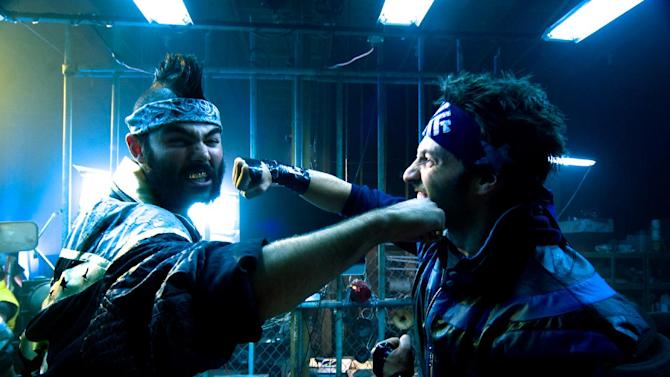 "In this film publicity image released by Drafthouse Films, Lee Valmassy, left, and Brandon Barrera are shown in a scene from ""The FP."" (AP Photo/Drafthouse Films)"