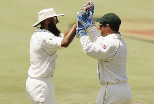 CENTURION, SOUTH AFRICA - JANUARY 12:  Mark Boucher of South Africa congratulates Hashim Amla on the wicket of Inzamam-ul-Haq during Day Two of the First Test match between South Africa and Pakistan a