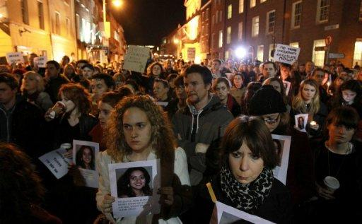 Protestors hold pictures of Savita Halappanavar on November 14, 2012, who was allegedly refused an abortion that could have saved her life in Ireland. The country will introduce draft legislation and regulations to provide limited abortion in cases where the mother's life is at risk, the government announced.