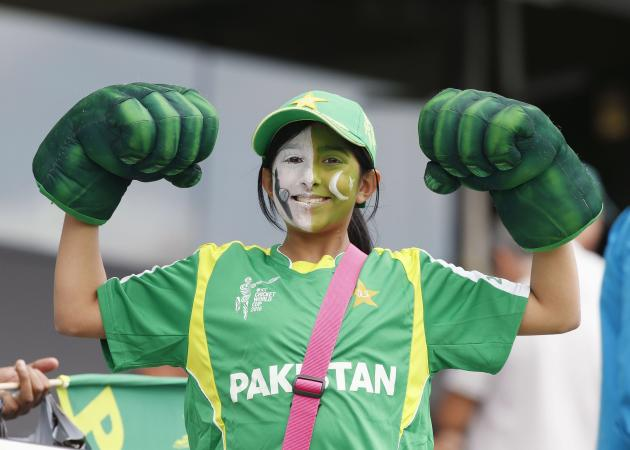 A young Pakistani fan shows her muscles before South Africa's Cricket World Cup match against Pakistan in Auckland