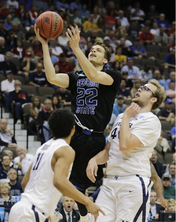 FILE - In this March 21, 2015, file photo, Georgia State guard R.J. Hunter (22) goes in for a shot between Xavier's Dee Davis, left, and Xavier's Matt Stainbrook during the first half of an NC