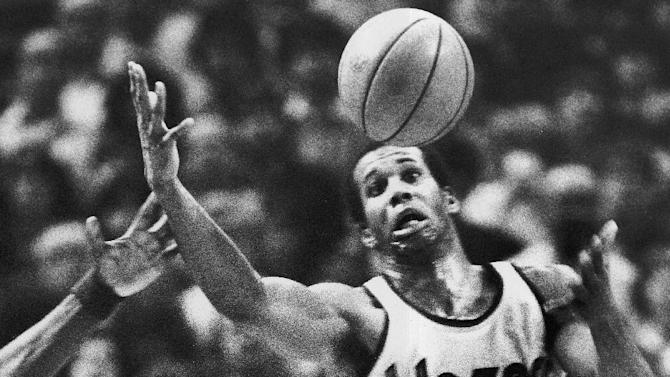 FILE - In this Dec. 25, 1979, file photo, Portland Trail Blazers' Kermit Washington gains control of a loose ball during an NBA basketball game against the Golden State Warriors in Portland, Ore. Former NBA player Kermit Washington is accused of using donations intended to help needy people in Africa for his own gain, including paying for vacations, jewelry and entertainment. U.S. Attorney Tammy Dickinson on Wednesday, May 25, 2016, announced a federal indictment against Washington. (AP Photo/Jack Smith, File)