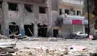 An image released by the Syrian opposition's Shaam News Network shows destruction at a neighbourhood in the central flashpoint city of Homs on June 19. The Red Cross said it will try to evacuate hundreds of civilians trapped by fierce fighting in and around the restive city of Homs, as violence killed dozens of people across Syria
