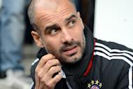 Spanish Pep Guardiola watches a training session in Weiden, southern Germany on June 29, 2013. Guardiola has said he is toying with the idea of playing some of his stars out of position as the new coach looks to find his preferred starting line-up at the European champions