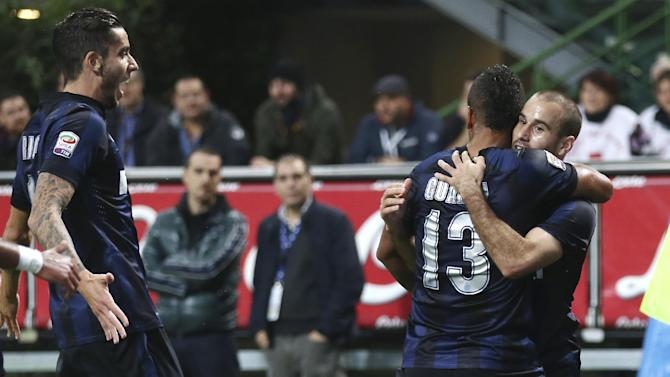 Inter Milan forward Rodrigo Palacio, right, of Argentina, celebrates with his teammates Colombian midfielder Fredy Guarin, center, and midfielder Ricardo Alvarez, of Argentina, after scoring during the Serie A soccer match between Inter Milan and Hellas Verona at the San Siro stadium in Milan, Italy, Saturday, Oct. 26, 2013