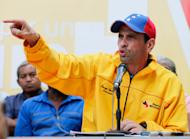 Opposition leader Henrique Capriles speaks during a news conference in Caracas, Venezuela, Sunday, Feb. 16, 2014. Capriles spoke about his solidarity with opposition leader Leopoldo Lopez after Venezuelan security forces raided the homes of Lopez and his parents, looking to arrest the hard-line opposition leader who President Nicolas Maduro blames for three deaths in recent anti-government protests. (AP Photo/Fernando Llano)