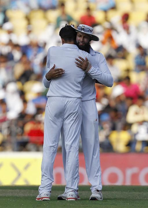 South Africa's Tahir is hugged by his captain Amla after he took the wicket of Mishra during the second day of their third test cricket match in Nagpur