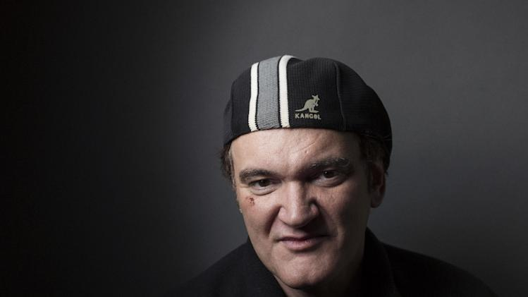 "In this Sunday, Dec. 16, 2012 photo, director Quentin Tarantino poses in New York for a portrait in promotion of ""Django Unchained."" The film, starring Jamie Foxx, Kerry Washington, Don Johnson and Christoph Waltz, centers on a slave trying to rescue his wife from a Mississippi plantation. (Photo by Victoria Will/Invision/AP)"