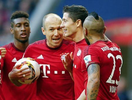 Munich players celebrate a goal against VfB Stuttgart during their Bundesliga first division soccer match in Munich