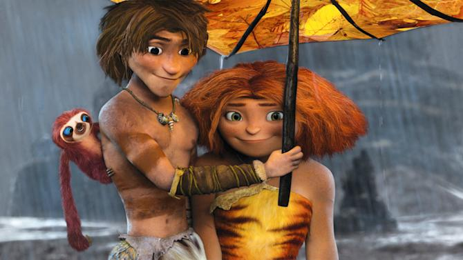 """This film publicity image released by DreamWorks Animation shows, from left, Belt the sloth, voiced by Chris Sanders, Guy, voiced by Ryan Reynolds, and Eep, voiced by Emma Stone, in a scene from """"The Croods."""" (AP Photo/DreamWorks Animation)"""