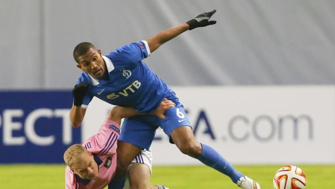Dinamo Moscow's Vainqueur challenges Anderlecht's Deschacht during their Europa League round of 32 second leg soccer match in Khimki