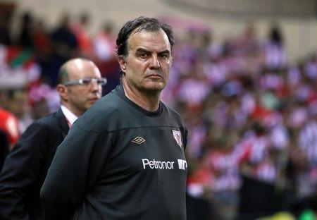 Athletic Bilbao's coach Bielsa stands on the pitch before the start of their Spanish King's Cup soccer final against Barcelona in Madrid