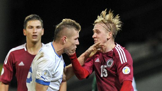 Latvia's Artis Lazdins, right, confronts Slovakia's Juraj Kucka during a World Cup 2014 Group G qualification match in Riga, Latvia, on Tuesday. Oct. 15, 2013