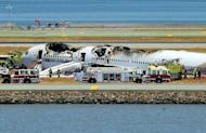 An Asiana Airlines Boeing 777 passenger jet crashed and burst into flames as it landed short of the runway at San Francisco International Airport, killing two people and injuring 182 others