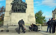 A Canadian soldier who was shot outside the war memorial on Parliament Hill in tended to in Ottawa October 22, 2014. REUTERS/Daniel Thibeault/CBC