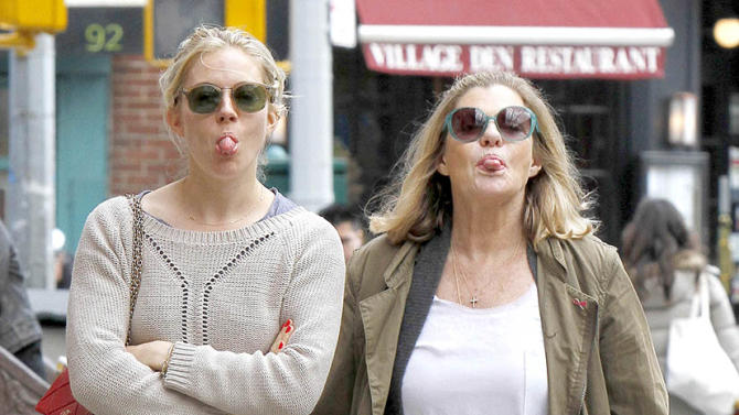 SIENNA MILLER STICKS HER TONGUE