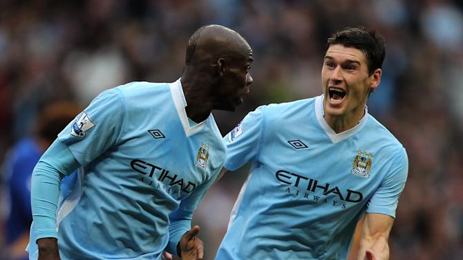 Mario Balotelli, left, has been backed to start firing by Gareth Barry