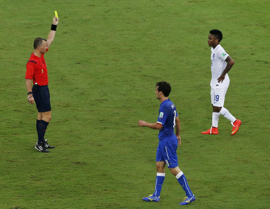 England's Sterling is shown the yellow card by the referee during their 2014 World Cup Group D soccer match against Italy at the Amazonia arena in...